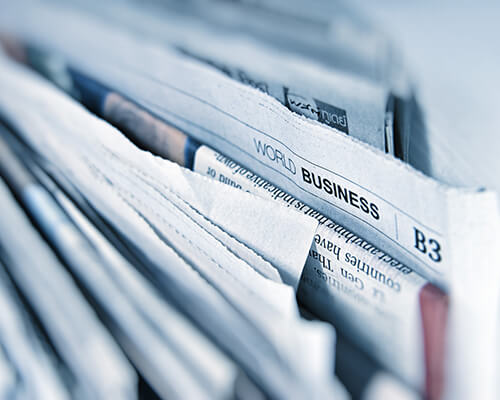 Photo of newspapers.