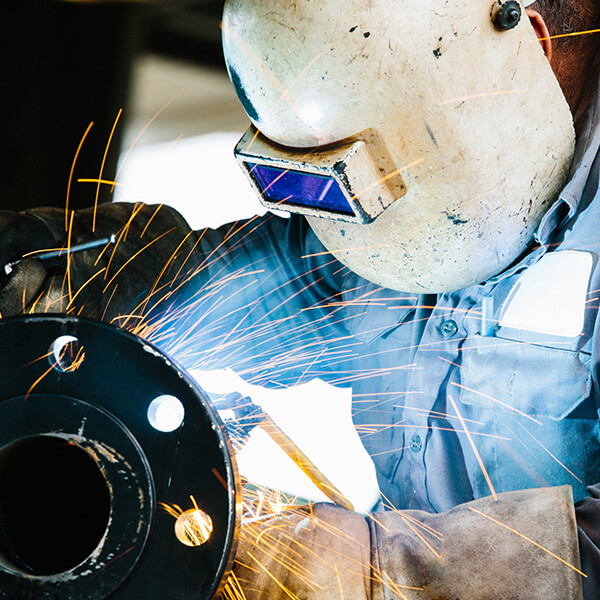 Photo of a welder working.